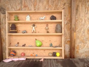 Kristal started a shelf for all the figurines found in the yard debris piles.